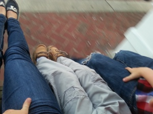Our feet, on a bench swing.